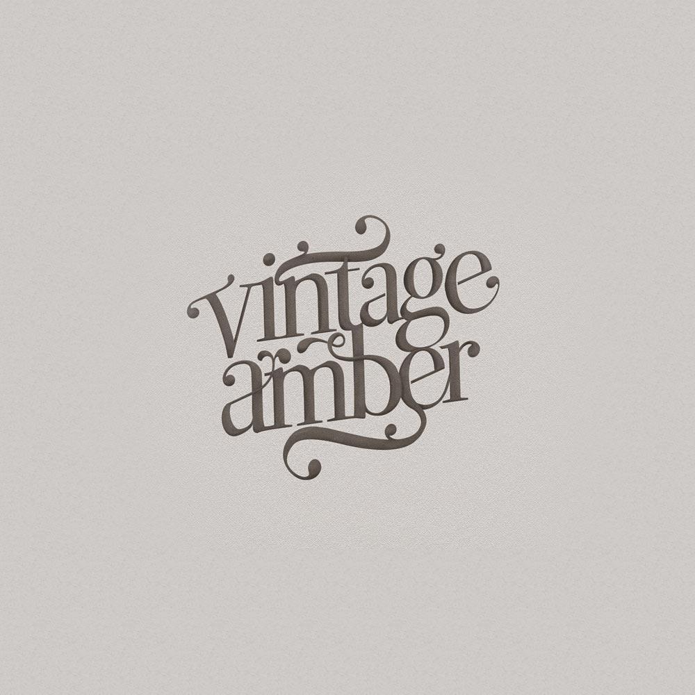Balta-ideja-socialinio-marketingo-ir-dizaino-agentura-PORTFOLIO-vintage-amber-logotipas